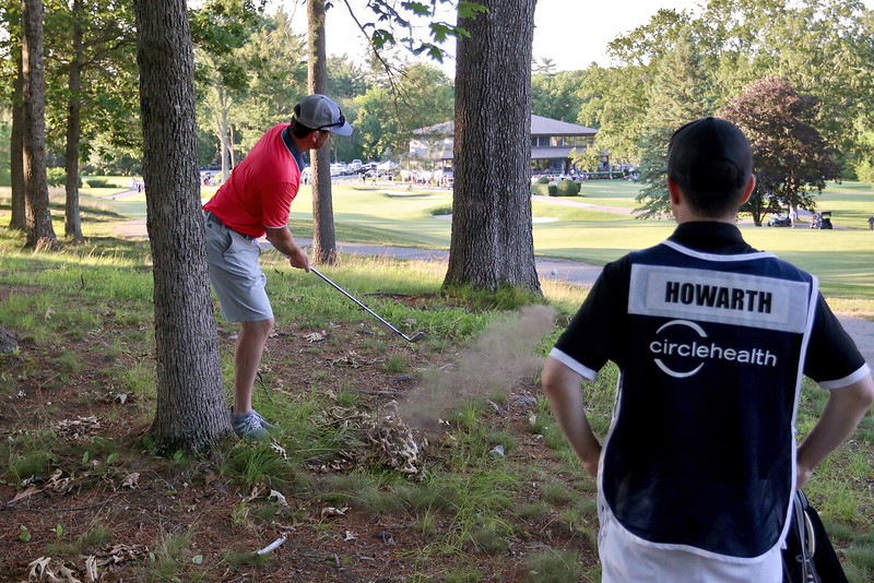 Jason Howarth make a shoot from the just off the fairway during the Lowell City Golf Tournament at Vesper Country Club in Tyngsboro on Wednesday afternoon. Wath him is caddy Pat Moriarty. SUN/JOHN LOVE