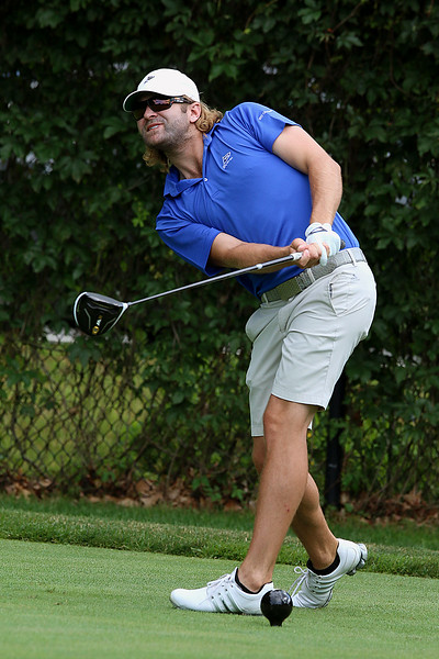 Winner of the Lowell City Golf Tournament at Vesper Country Club in Tyngsboro Rich Campiola reacts to his tee shot during the match. SUN/JOHN LOVE