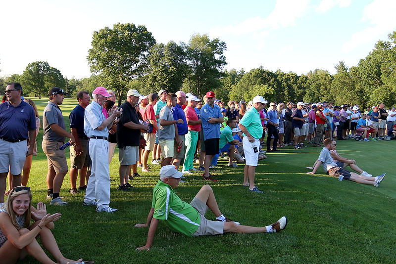 Spectators watch Scott Pare, Mike Walker and Rich Campiola as they compete in the Lowell City Golf Tournament at Vesper Country Club in Tyngsboro on Wednesday afternoon. SUN/JOHN LOVE
