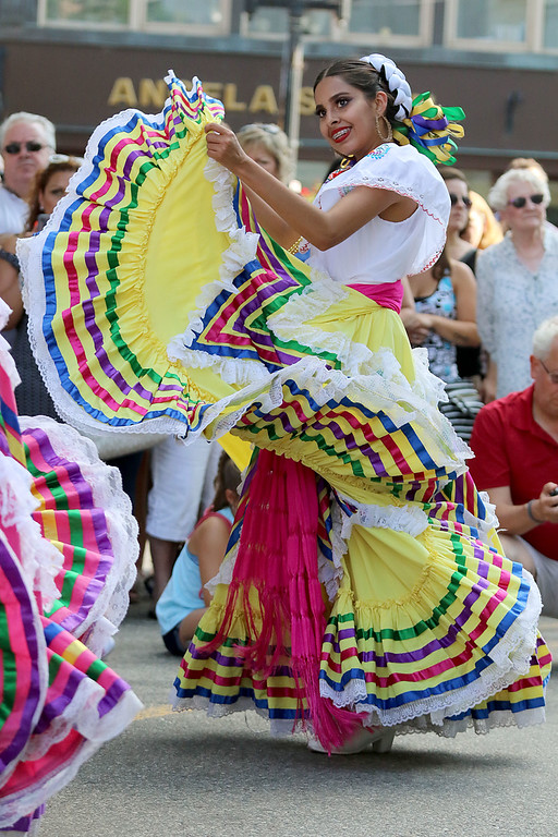 . The last day of 2018 Folk Festival was packed with good food and great performances. Alama Acosta dances to the music of Mariachi Mexico Antiguo band as she performes with the Ballet Folklórico De Mi Tierra dancers from Las Vagas at the corner of John and Merrimack Streets during the festival. LOWELL SUN/JOHN LOVE