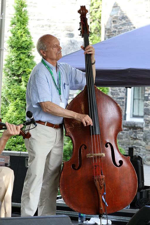 . The last day of 2018 Folk Festival was packed with good food and great performances. Jay Young plays the string base with the Don Roy Trio on the Saint Anne\'s Churchyard stage during the festival. LOWELL SUN/JOHN LOVE