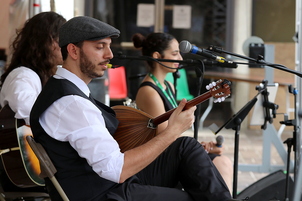 . The last day of 2018 Folk Festival was packed with good food and great performances. Dimitris Mann plays the bouzouki as he performs with the Rebetiko Trio on the JFK Plaza stage at the festival on Sunday. LOWELL SUN/JOHN LOVE
