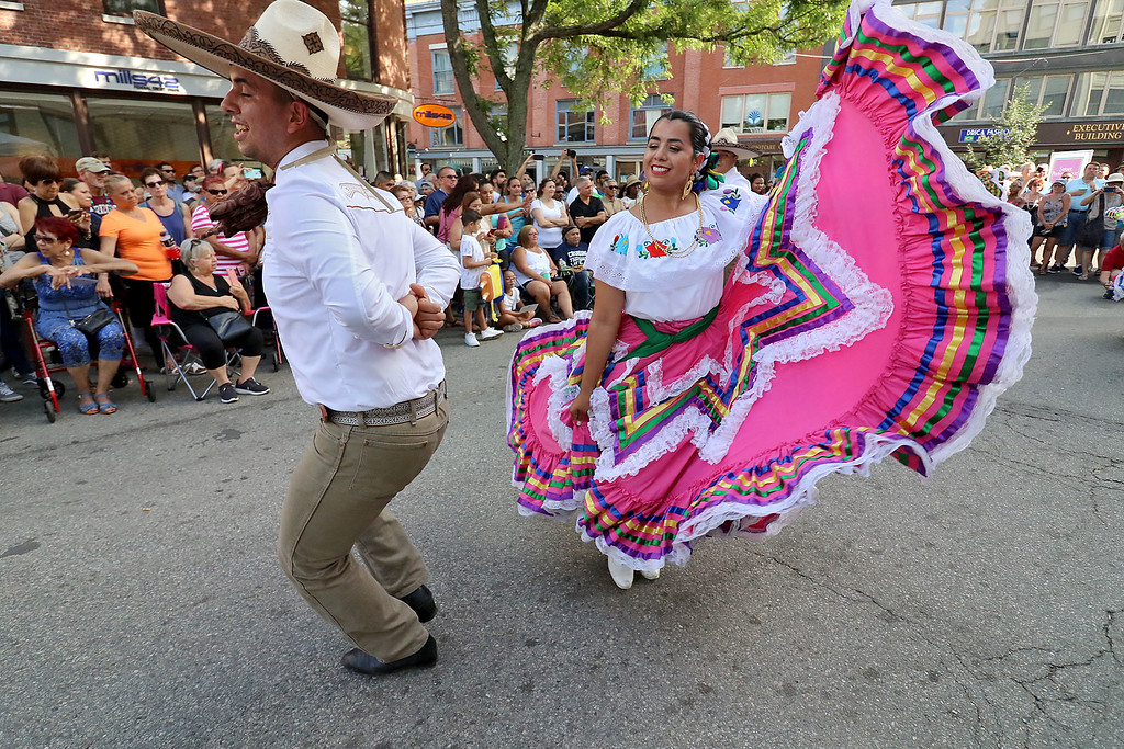 . The last day of 2018 Folk Festival was packed with good food and great performances. Jose Pina dances with Karina Cavada to the music of Mariachi Mexico Antiguo band as they perform with the Ballet Folklórico De Mi Tierra dancers from Las Vagas at the corner of John and Merrimack Streets during the festival. LOWELL SUN/JOHN LOVE