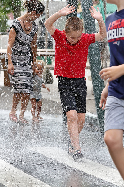 . The last day of 2018 Folk Festival was packed with good food and great performances. It was hot during the last day of the festival so many tried to stay cool like Nick Brandolo, 6, of Mansfield by running through the cooling station on Market Street. LOWELL SUN/JOHN LOVE