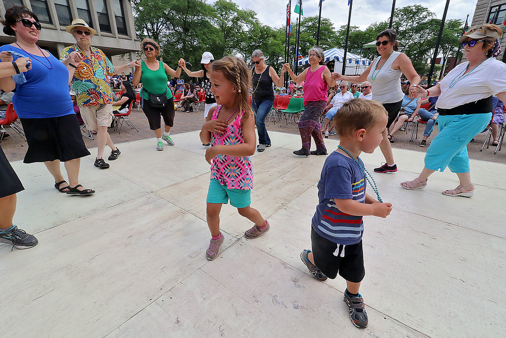 . The last day of 2018 Folk Festival was packed with good food and great performances. Ellie, 5, and her brother Eddy Gunzelmann, 3, of Hampton New Hampshire dance in the center of other dancers dancing to the Greek sounds of the group Rebetiko Trio. LOWELL SUN/JOHN LOVE