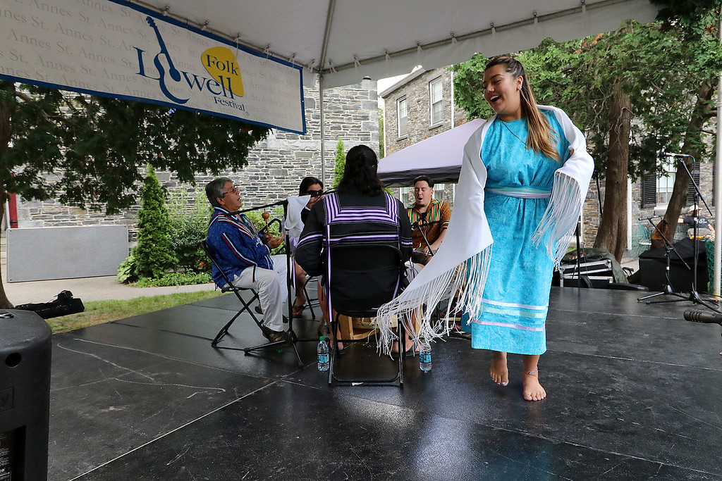 . The last day of 2018 Folk Festival was packed with good food and great performances. Selena Neptune Bear dances around the Saint Anne\'s Churchyard stage as the Burnurwurbskek Singers play a drum during the festival. The performers were all from the Penobscot tribe. LOWELL SUN/JOHN LOVE