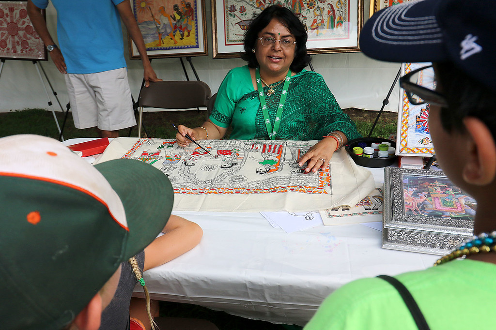 . The last day of 2018 Folk Festival was packed with good food and great performances. Sunanda Sahay explains the painting, she was working on, from north India called Mithila at her booth at the festival on Sunday. LOWELL SUN/JOHN LOVE