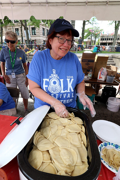 The last day of 2018 Folk Festival was packed with good food and great performances. Shirley Garvey gets ready to dish up some Polish cheese pierogi's at the festival on Sunday. LOWELL SUN/JOHN LOVE