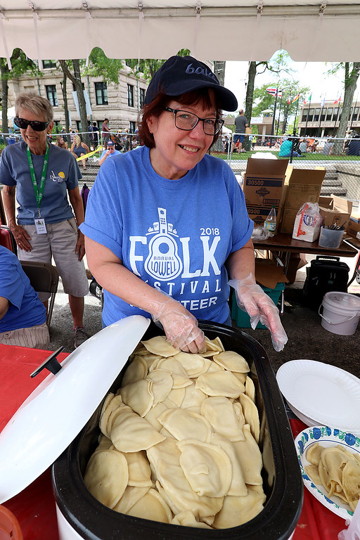 . The last day of 2018 Folk Festival was packed with good food and great performances. Shirley Garvey gets ready to dish up some Polish cheese pierogi\'s at the festival on Sunday. LOWELL SUN/JOHN LOVE