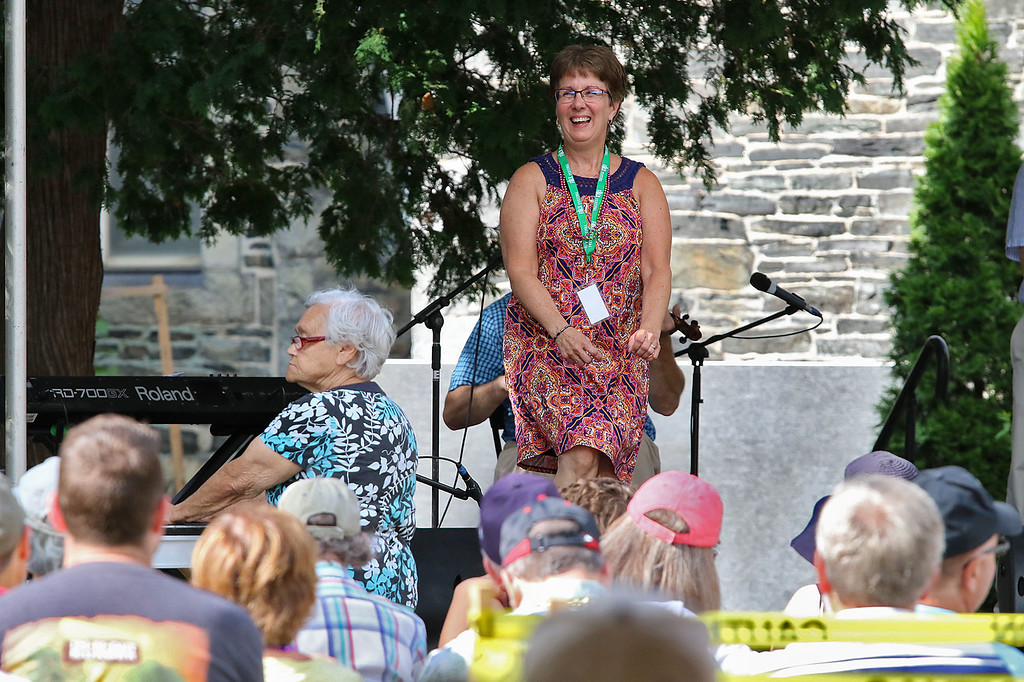. The last day of 2018 Folk Festival was packed with good food and great performances. Cindy Roy of Maine does some dancing with the Don Roy Trio on the Saint Anne\'s Churchyard stage during the festival. LOWELL SUN/JOHN LOVE
