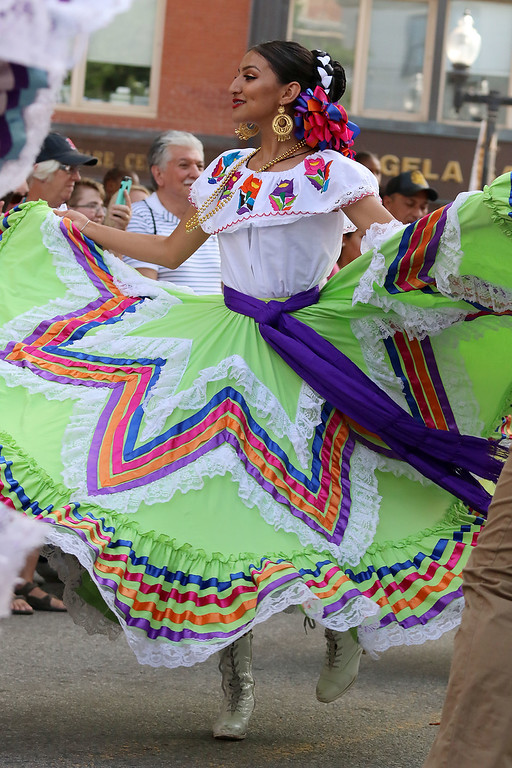 . The last day of 2018 Folk Festival was packed with good food and great performances. Lizebeth Godoy dances to the music of the Mariachi Mexico Antiguo band as she performes with the Ballet Folklórico De Mi Tierra dancers from Las Vagas at the corner of John and Merrimack Streets during the festival. LOWELL SUN/JOHN LOVE
