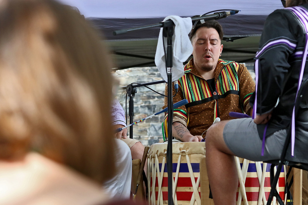 . The last day of 2018 Folk Festival was packed with good food and great performances. Nicholas Bear performs with the Burnurwurbskek Singers as they performed on the Saint Anne\'s Churchyard stage during the festival. The group was from the Penobscot tribe. LOWELL SUN/JOHN LOVE
