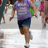 The last day of 2018 Folk Festival was packed with good food and great performances. It was hot during the last day of the festival so many tried to stay cool like Elanna Rivera, 8, of Nashua by running through the cooling station on Market Street. LOWELL SUN/JOHN LOVE