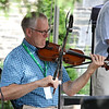 The last day of 2018 Folk Festival was packed with good food and great performances. Don Roy plays the fiddle with the Don Roy Trio on the Saint Anne's Churchyard stage during the festival. LOWELL SUN/JOHN LOVE