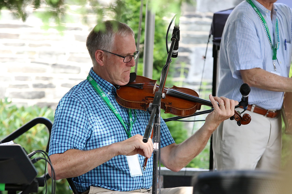 . The last day of 2018 Folk Festival was packed with good food and great performances. Don Roy plays the fiddle with the Don Roy Trio on the Saint Anne\'s Churchyard stage during the festival. LOWELL SUN/JOHN LOVE