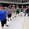 The last day of 2018 Folk Festival was packed with good food and great performances. A dance floor was put down so festival goers could dance to the Greek sounds of the group Rebetiko Trio as they performed at the JFK Plaza stage during the festival. LOWELL SUN/JOHN LOVE