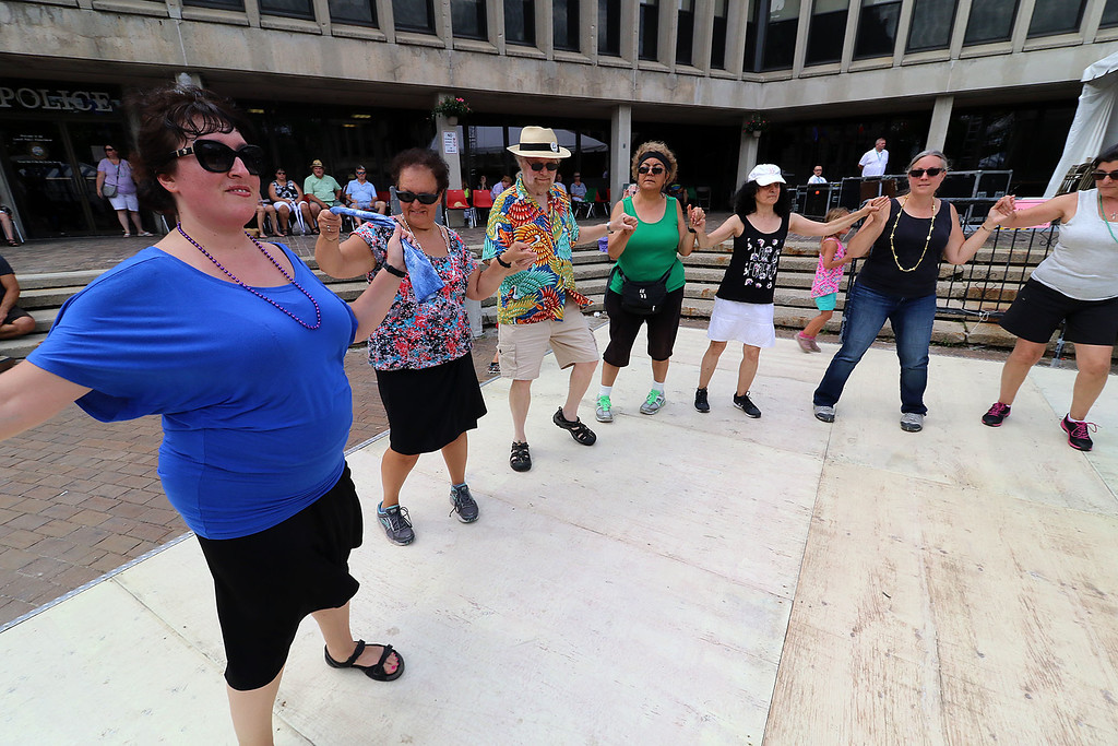 . The last day of 2018 Folk Festival was packed with good food and great performances. A dance floor was put down so festival goers could dance to the Greek sounds of the group Rebetiko Trio as they performed at the JFK Plaza stage during the festival. LOWELL SUN/JOHN LOVE