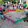 The last day of 2018 Folk Festival was packed with good food and great performances. Kid play some box hockey on Shattuck Street during the festival. LOWELL SUN/JOHN LOVE