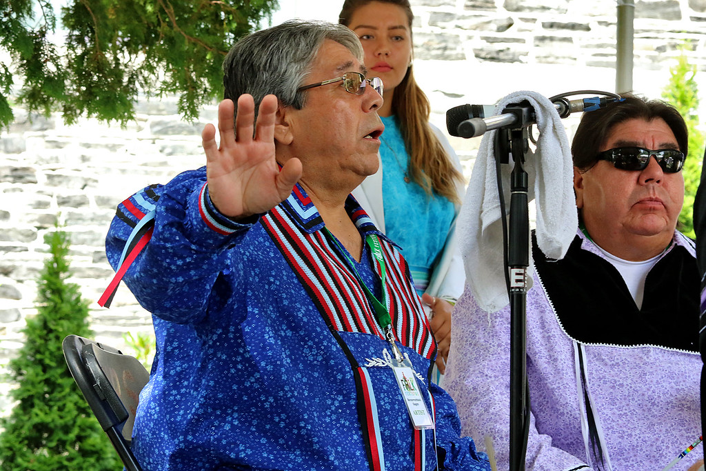 . The last day of 2018 Folk Festival was packed with good food and great performances. Dean Francis with the Burnurwurbskek Singers addresses the crowd before one of their songs as they performed on the Saint Anne\'s Churchyard stage during the festival. The group was from the Penobscot tribe. LOWELL SUN/JOHN LOVE