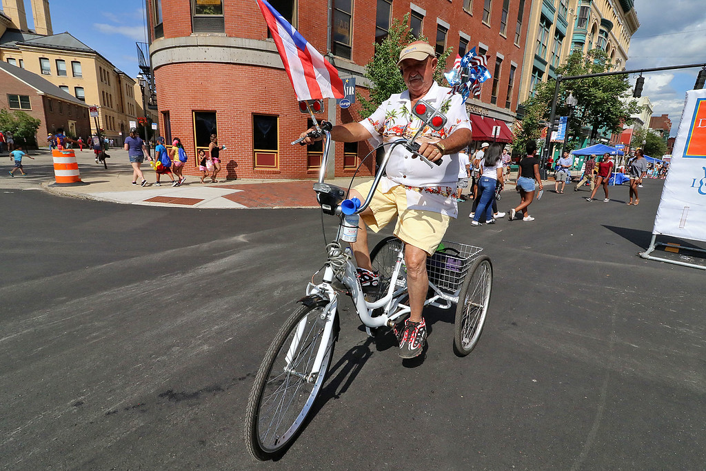 . The last day of 2018 Folk Festival was packed with good food and great performances. Gregorio Ortiz of Lowell found a great way to get around the festival on the last day. LOWELL SUN/JOHN LOVE