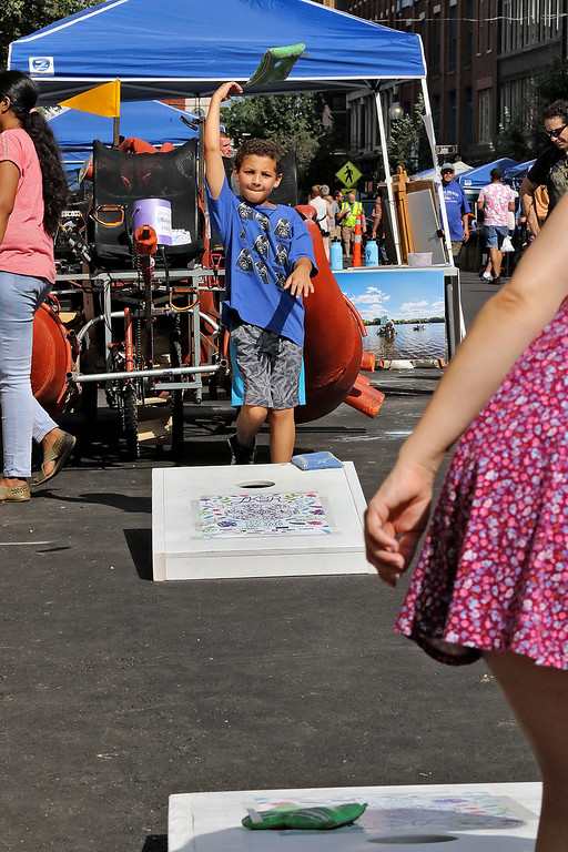 . The last day of 2018 Folk Festival was packed with good food and great performances. Jayden Perez, 10, plays some cornhole with his mom Lindsey Daley, both of Tewksbury, on Merrimack Street during the festival. LOWELL SUN/JOHN LOVE