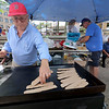 The last day of 2018 Folk Festival was packed with good food and great performances. Bill Kafkas cooks up some ground lamb for some gyro's at the Greek food booth at the festival on Sunday. LOWELL SUN/JOHN LOVE