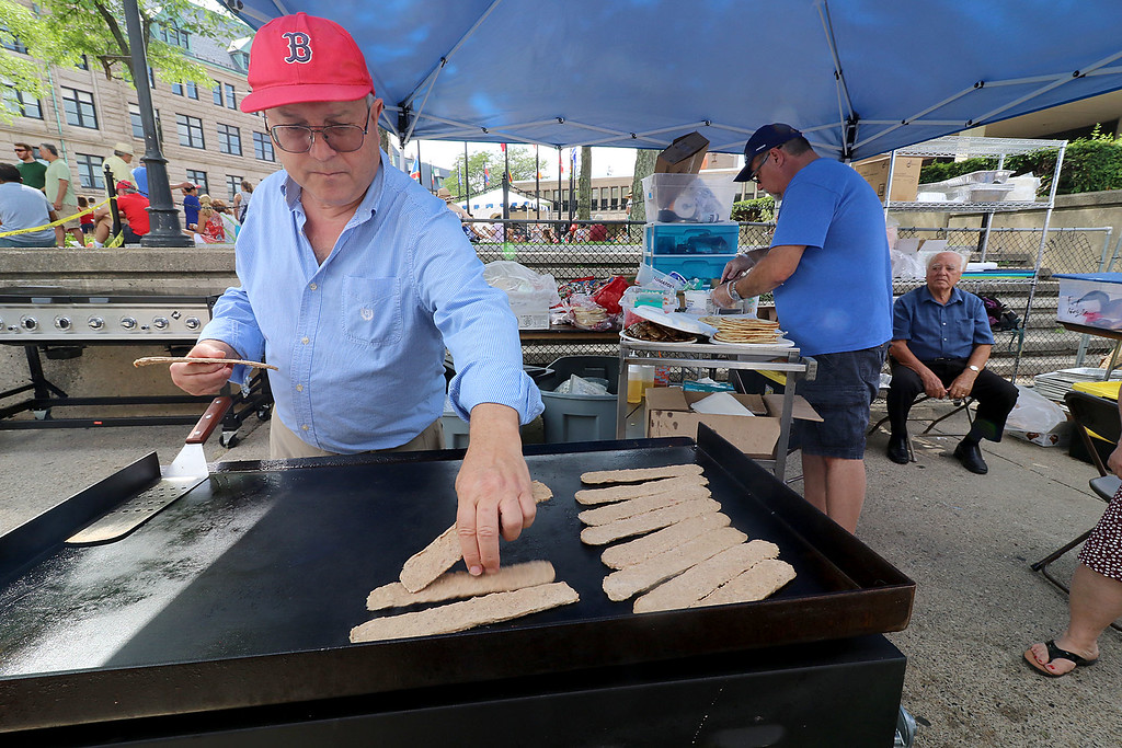 . The last day of 2018 Folk Festival was packed with good food and great performances. Bill Kafkas cooks up some ground lamb for some gyro\'s at the Greek food booth at the festival on Sunday. LOWELL SUN/JOHN LOVE