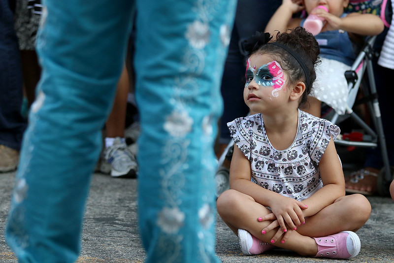 The last day of 2018 Folk Festival was packed with good food and great performances. Savanna Collozo, 3, of Lowell listens to the Mariachi Mexico Antiguo band with the Ballet Folklórico De Mi Tierra dancers from Las Vagas as they performed at the corner of John and Merrimack Streets during the festival. LOWELL SUN/JOHN LOVE