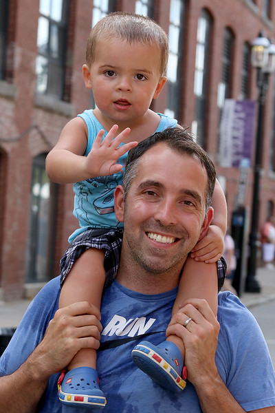 The last day of 2018 Folk Festival was packed with good food and great performances. Joe Dussault and his son James, 2, of Chelmsford just cooled off in the cooling station on Market Street late on the last day of festival. LOWELL SUN/JOHN LOVE