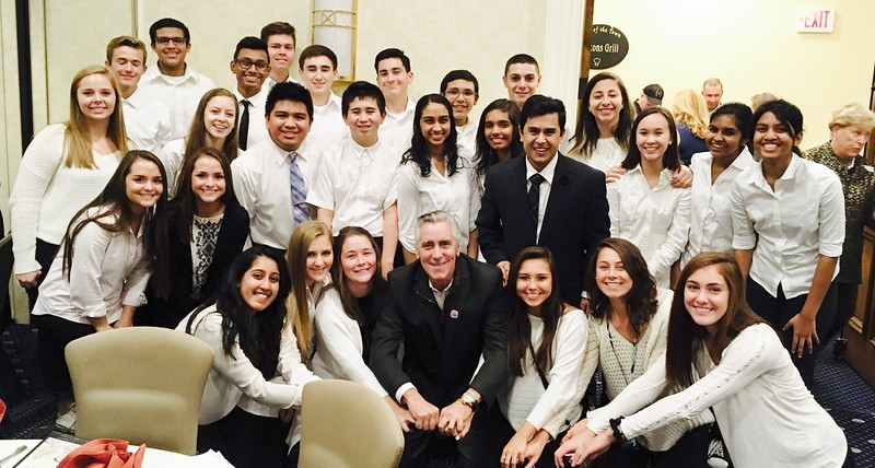 LGH student volunteers with radio and TV personality Billy Costa, center