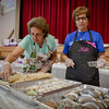 From left, Christina Panos of Tewksbury and Niki Kanavas of Lowell sell some delicious Greek pastries at the Greek Festival in Lowell. SUN/Caley McGuane