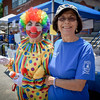 From left, Athena Hayes (Bubbles the Clown) of Lowell and Niki Ladakos of Tewksbury have fun at the Greek Festival in Lowell. SUN/Caley McGuane