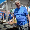 Angelos Kokkinos of Ayer cooks some bread for the delicious Gyros served at the Greek Festival in Lowell. SUN/Caley McGuane