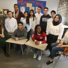 Lowell High ELL history teacherJessica Lander of Cambridge, left, with students whose op-eds will be published in The Sun. Seated, from left, juniors Phatphomviracboth Soeur, Rebecca Bitegetsimana and Riyam Abdulelah. Standing: junior Yan Carlos Cordero, seniors Jaafar Al Ogaili and Mika Nakamura, junior Stendy Ly, sophomore Julian Viviescas, juniors Luiz Gustava Oliveira de Brida and Abdiel Gonzalez, and senior Ghadeer Jawad. (SUN/Julia Malakie)