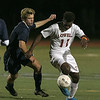 Lowell High School soccer played a Div. 1 North Quarter final game against St. John's Prep. on Monday afternoon in Lowell. LHS player Meyele Malango tries to control the ball as St. John's player #9 Kevin Casey tries to take it from him during action in the game. SUN/JOHN LOVE
