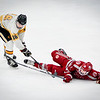 At left, Latin Academy's Ryan Lonergan shoves Lowell High's Jacob Heartquist to the ground during their hockey final. SUN/Caley McGuane