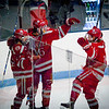Lowell High teammates celebrate a goal made against Latin Acamedy. SUN/Caley McGuane