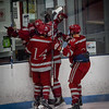 Lowell High teammates celebrate their first goal against Latin Academy. SUN/Caley McGuane