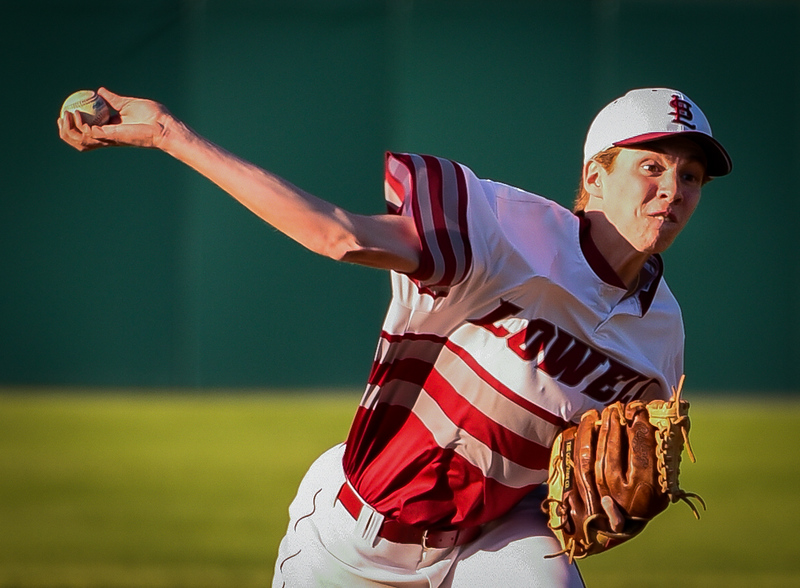 . Lowell High team captain and pitcher, Matt Draper, pitches the first half of the game against Newton North Monday.  Lowell Red Raiders win 7-4.   SUN/Scot Langdon