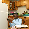The Lowell Housing Authority is selling some of its scattered site apartments in order to reduce maintenance costs and generate money to build a new development. Some families are being forced to move because of this. Bisoka Msfiri, 12, hangs out in his kitchen in one Lowell Hosing Authority's apartments that might be sold. SUN/JOHN LOVESUN/JOHN LOVE