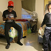 The Lowell Housing Authority is selling some of its scattered site apartments in order to reduce maintenance costs and generate money to build a new development. Some families are being forced to move because of this. Innocent Pascal and his brother Songolo Msafiri, 6, hang out in one of the bedrooms in one Lowell Hosing Authority's apartments that might be sold. SUN/JOHN LOVE