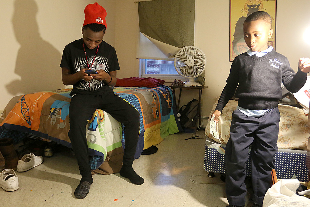 . The Lowell Housing Authority is selling some of its scattered site apartments in order to reduce maintenance costs and generate money to build a new development. Some families are being forced to move because of this. Innocent Pascal and his brother Songolo Msafiri, 6, hang out in one of the bedrooms in one Lowell Hosing Authority\'s apartments that might be sold. SUN/JOHN LOVE