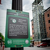 A trail sign talks about the history of the Bell-evator Tower which is directly across the street in this photo. SUN/Caley McGuane