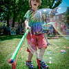 Sidney Otis, 6, of Lowell has fun at with giant bubbles at the Lowell Pride Festival. SUN/Caley McGuane