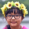 When you go to the Lowell Southeast Asian Water Festival wear flowers in your hair, as seen here with Davynus Doung 10 of Lowell. SUN/David H. Brow
