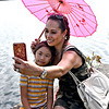 Doing a selfie is Vong Boualaphanh of Lowell, with her neice Mamida Lo 8, also from Lowell. SUN/David H. Brow