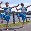 Members of the Cambodian Dancers of Rhode Island strike a pose after dancing on stage at the Lowell Southeast Asian Water Festival, L-R, Madeline Ith 16, and Norin Samraing 15, both girls are from Smithfield RI. SUN/David H. Brow