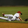 Lowell Spinners second baseman Andy Perez dives for a ground ball and fires to first fromhis knees for the out during their game against the Connecticut Tigers on Wednesday night. SUN/JOHN LOVE