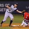 The Lowell Spinners Tyler Hill  is tagged out as he slides into second by Colby Woodmansee of the Brooklyn Cyclones during Monday nights game. SUN/JOHN LOVE