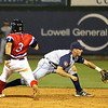 The Lowell Spinners Chris Madera is just a bit late to second as Brooklyn Cyclones Colby Woodmansee gets the throw from the outfield during Monday nights game. SUN/JOHN LOVE